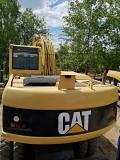 Экскаватор CAT M318C Minsk